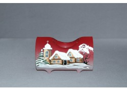 Candlestick, in the shape of a Christmas cylinder from glass, in red decor