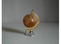 Globus zo skla v tmavo oranžovej farbe