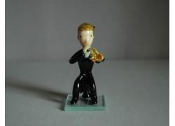 Figurine, musician playing on trumpet www.sklenenevyrobky.cz