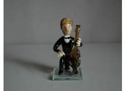 Figurine, musician playing violoncello www.sklenenevyrobky.cz