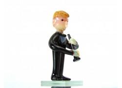 Figurka - hudebník hrající na klarinet